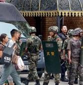 China sentences 32 Uighurs in Xinjiang for videos
