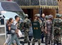 China sentences 32 Uighurs in Xinjiang for videos